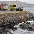 The car after it ended up in the sea near Deborah Bay, Dunedin, yesterday. PHOTO: LINDA ROBERTSON