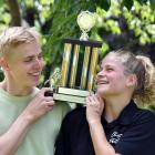 John Gerber and Eliza Meekings celebrate with the trophy after winning the men's and women's...