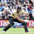 Opener Martin Guptill plays an ungainly shot on his way to top-scoring with 97, laying the...
