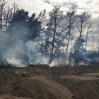 Smoke coming from the tyres before the site was smothered last weekend. Photo: Supplied /...