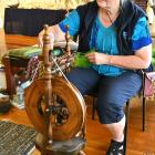Taieri Spinners and Weavers president Sarah Gamble spins some more yarn on her spinning wheel,...