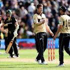 Black Caps bowlers Jimmy Neesham (left) and Trent Boult celebrate victory over Australia in the...