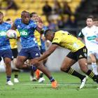 The Blues' Mark Telea makes a break against the Hurricanes. Photo: Getty Images