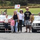 Otago Community Hospice staff and volunteers, along with their families, get ready to set off on...
