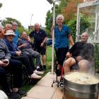 Residents and staff preparing a hangi at Bryndwr rest home, Radius Hawthorne. Photo: Supplied