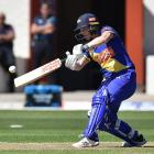 Katey Martin shows the style which saw her score 85 at the University of Otago Oval on Saturday....