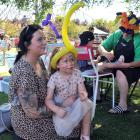 Enjoying the Mosgiel Party in the Park yesterday are (left) Shauney Macaskill and her daughter...