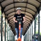 Neuron New Zealand regional manager Adam Muirson rides a Neuron Mobility e-scooter in Dunedin's...