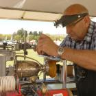 Stu Ide works to engrave the trophies at the Central Otago A&P Show in Omakau. PHOTO: ALEXIA...