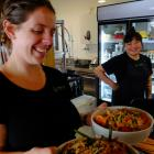 Head chef and cafe manager Louise Evans holds vegan salads at Horopito Cafe, Orokonui...