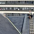 Slate roofer John Meegan puts the finishing touches on the roof of the former Dunedin Prison...
