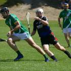 Wellington's Paddy Dempsey, playing for Queenstown's Band of Brothers, makes a break from...