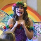 Rainbow Rosalind entertains children and their parents at a Christchurch earthquake fundraising...