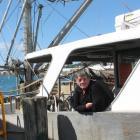 Oysterman John Edminstin prepares his fishing boat Polaris for the beginning of oyster season...