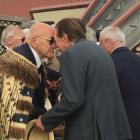 Sir Tipene O'Regan performs a hongi with Invercargill Mayor Sir Tim Shadbolt at the Waitangi Day...