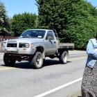 Lee Stream School principal Rachelle Moors watches motorists travel on the open road outside her...