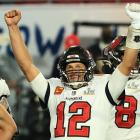 Tom Brady #12 of the Tampa Bay Buccaneers reacts after defeating the Kansas City Chiefs in Super...