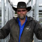 Outram Rodeo Club member Fred Doherty opens a gate in the new steel stockyards set for use during...