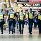 Police patrol the streets of Melbourne at the start of the 'circuit breaker' lockdown. Photo:...