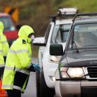 Police check reasons for travel to and from Auckland at a checkpoint north of Auckland recently....