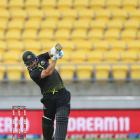 Australia captain Aaron Finch hits straight down the ground during his innings of 69 in the third...