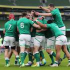 Ireland players celebrate their first try against England. Photo: Reuters
