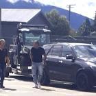 Destiny Church leader Brian Tamaki (right) in a supermarket car park in Te Anau on Tuesday. PHOTO...