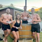 Just chilling: Preparing for a 23-minute ice bath in Queenstown on Tuesday night are, from left,...