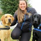 Assistance Dogs New Zealand Trust dog training co-ordinator Ashleigh Murray with Jack (left) and...