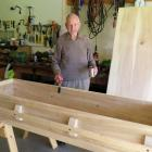Gilbert Donaldson prepares to add stain to the coffin he has been made from the wood of trees he...