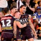 Brisbane Broncos players celebrate after a try last week. Photo: Getty Images