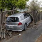 The car ploughed through this fence in the Christchurch suburb of Parklands on Thursday morning....