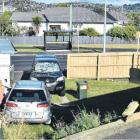 A silver car crashed through Lisa Lindon's fence and landed on top of her ute on Monday afternoon...