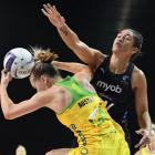 Kiera Austin of Australia is challenged by Sulu Fitzpatrick of New Zealand during the...