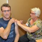 Dunedin Hospital emergency department clinical director Rich Stephenson receives his initial dose...