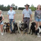 Ramona and Jim Sidey with their daughters Millie (left) and Hannah, and their team of dogs at...