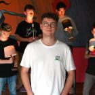 Director Harrison Kennedy surrounded by (from left) Conor Hill (19), Christian Tucker (22),...