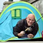 Fisherman Daniel Scorringe, of Dunedin, pitched his tent beside Otago Harbour yesterday morning...