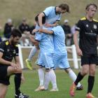 Striker Tom Fisher is hoisted aloft by his South City Royal team-mates after scoring against...