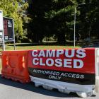 A sign saying campus closed at the University of Canterbury on March 26 last year. Photo: File /...