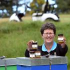 Otago Golf Club director of golf Shelley Duncan with some honey the club is now producing.PHOTO:...
