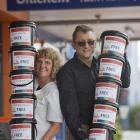 Nik and Paul Wild were busy yesterday delivering donation collection buckets to 35 local...