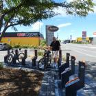Ron van Til has installed a $30,000 e-bike stand outside his bakery and cafe. Photo: Robyn Bristow