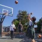 Christ's College senior A basketball players use the new basketball hoops with St James School...