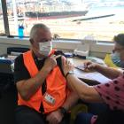 John McLister receives his Covid vaccine. Photo: John McLister