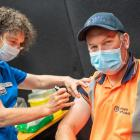Port Otago worker Josh Greer receives his first dose of the Covid-19 vaccine in Dunedin. PHOTOS:...