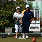 Malia Tavite (right), of Forbury Park, watches intently after delivering a bowl during the...