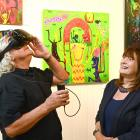 Trying out their own virtual reality art exhibition at Gallery de Novo in Dunedin is gallery...