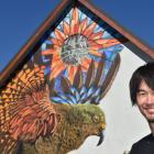 International street artist Koryu Aoshima with his kea creation at a former church in Hargest...