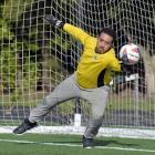 Al-Huda goal keeper Hassan Al-Saayed warms up for the Race Relations Week Tournament of the...